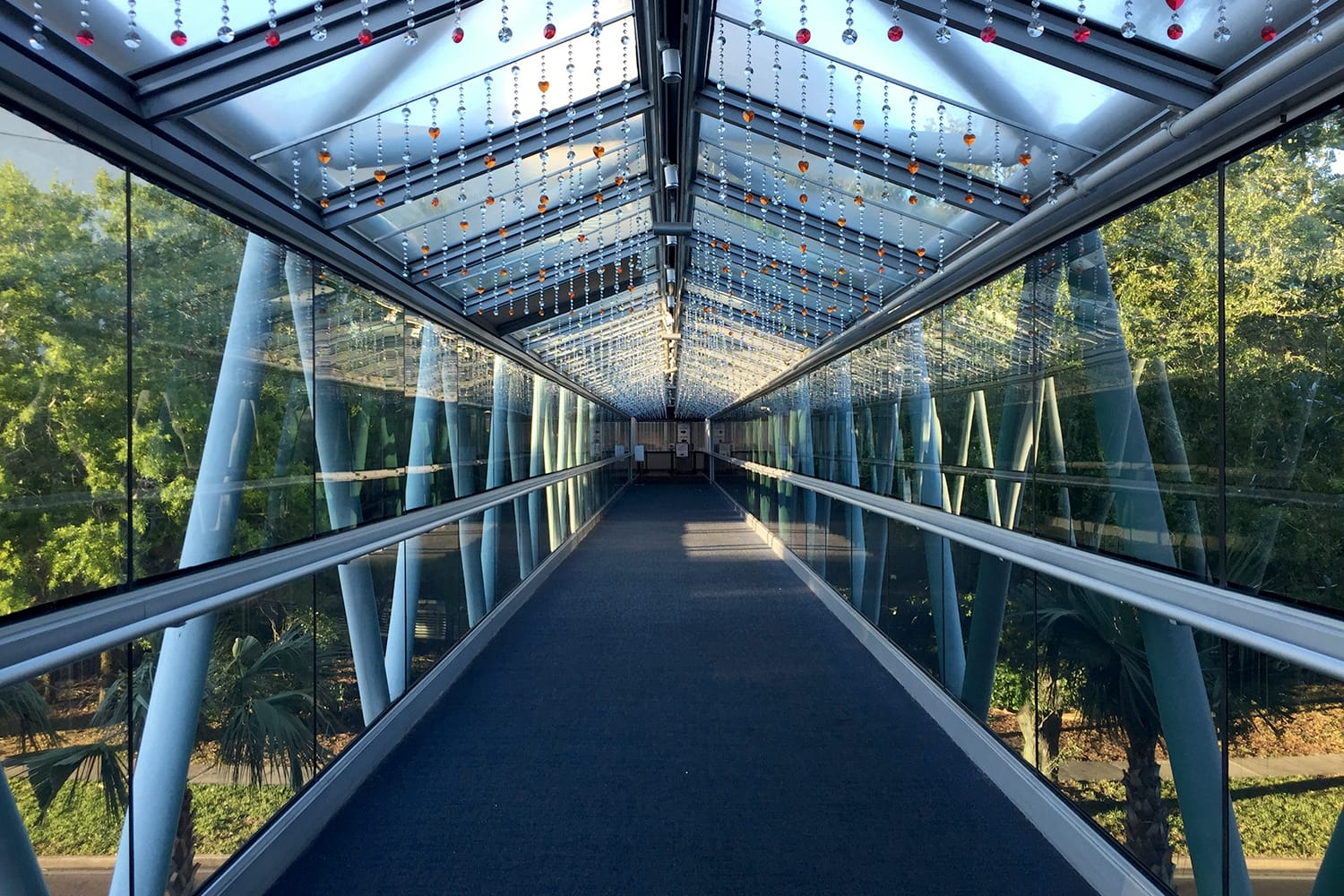 The Orlando Science Center's glass pedestrian bridge high above Princeton Street is adorned with a rainbow of heart shaped crystals hanging inside