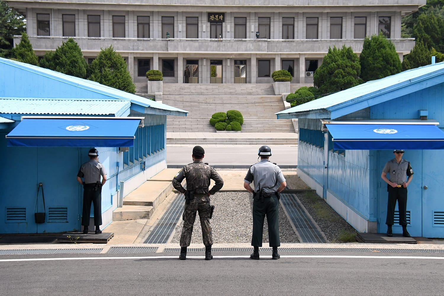The UN soldiers standing in front of the North Korea office building at Korean Demilitarized Zone, the bolder area between North Korea and South Korea, Panmunjom