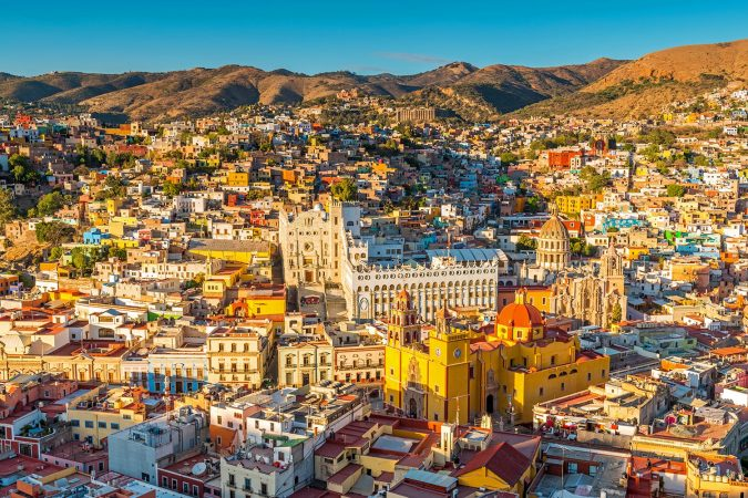 The last sun rays of the day shining on the skyline of Guanajuato city at sunset, Mexico.