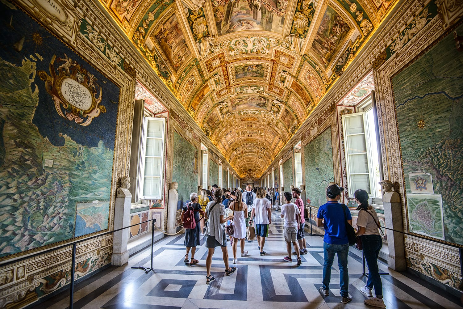 Panorama of people visiting and enjoying the Vatican Museum in Rome, Italy