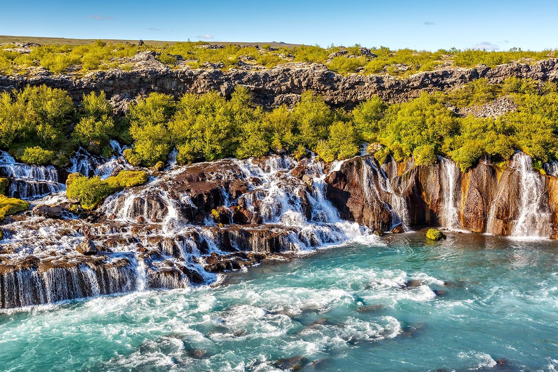 View of Hraunfossar waterfall in Iceland at sundown