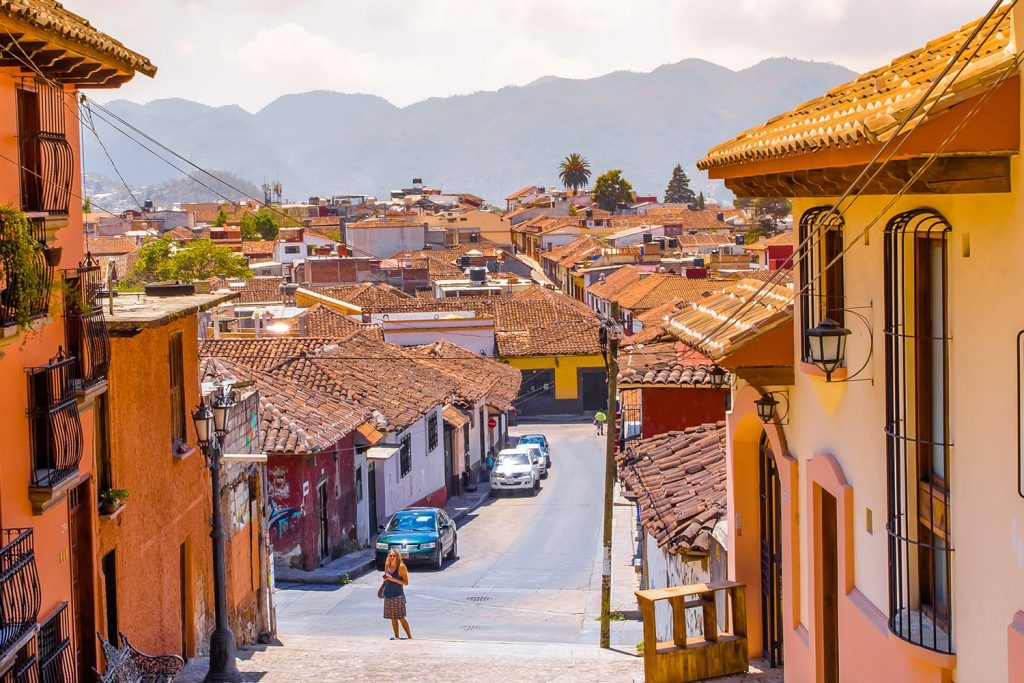 Street view and sidewalk in the historical centre of San Cristobal de las Casas, Mexico