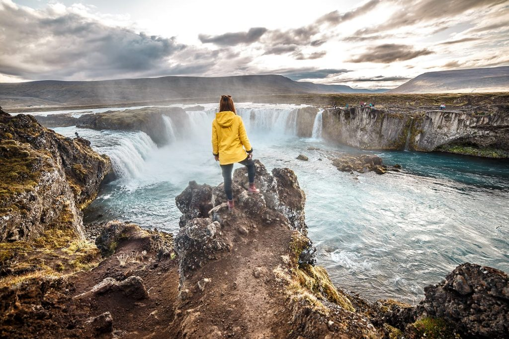 Tourist overlooking waterfall on Golden Circle in Iceland