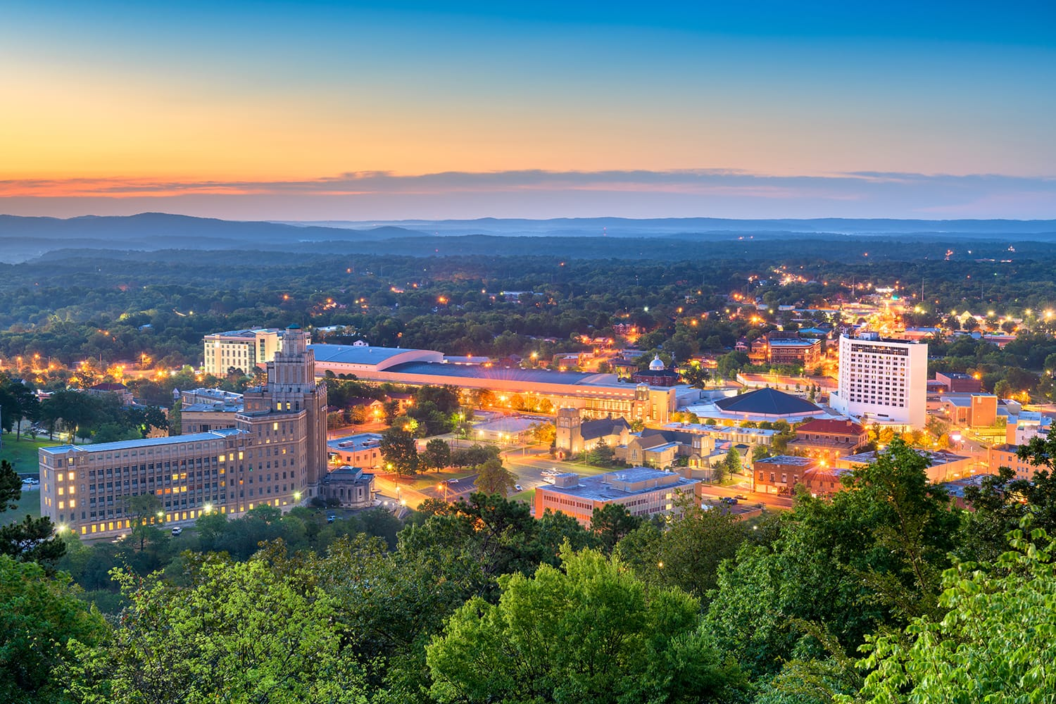 Hot Springs, Arkansas, USA town skyline from above at dawn.