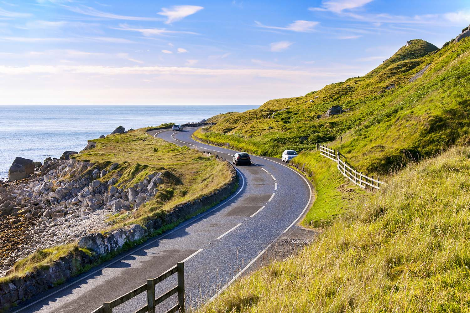 The eastern coast of Northern Ireland and Antrim Coastal road with cars