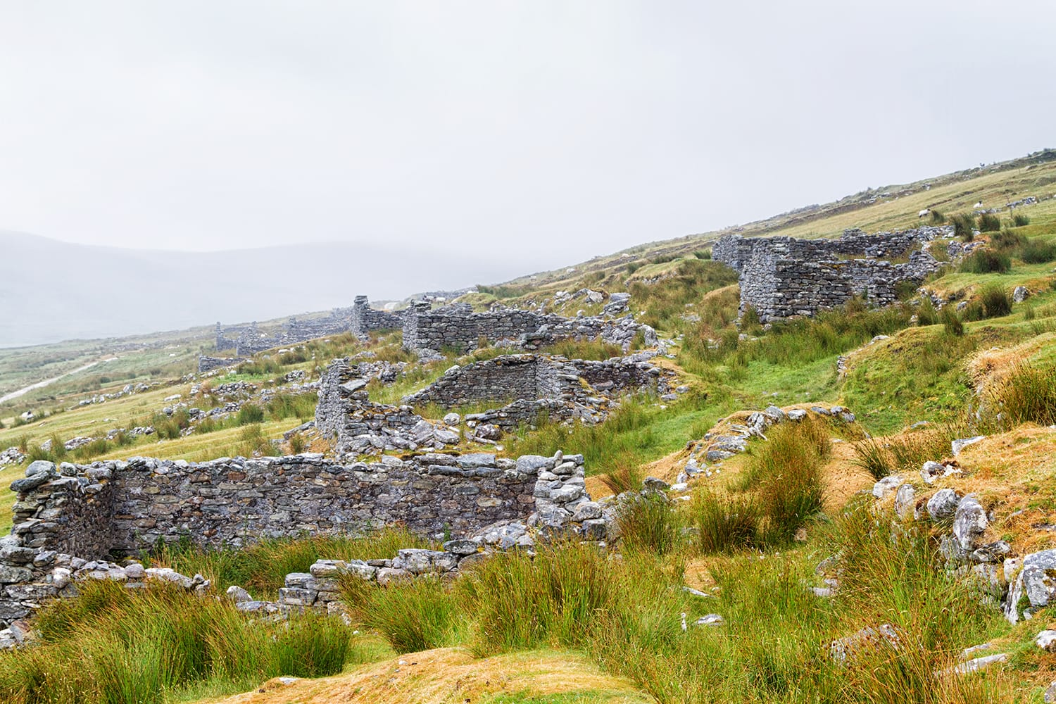 Abandoned dry stone cottages in the deserted village of Slievemore in Achill Island, Ireland