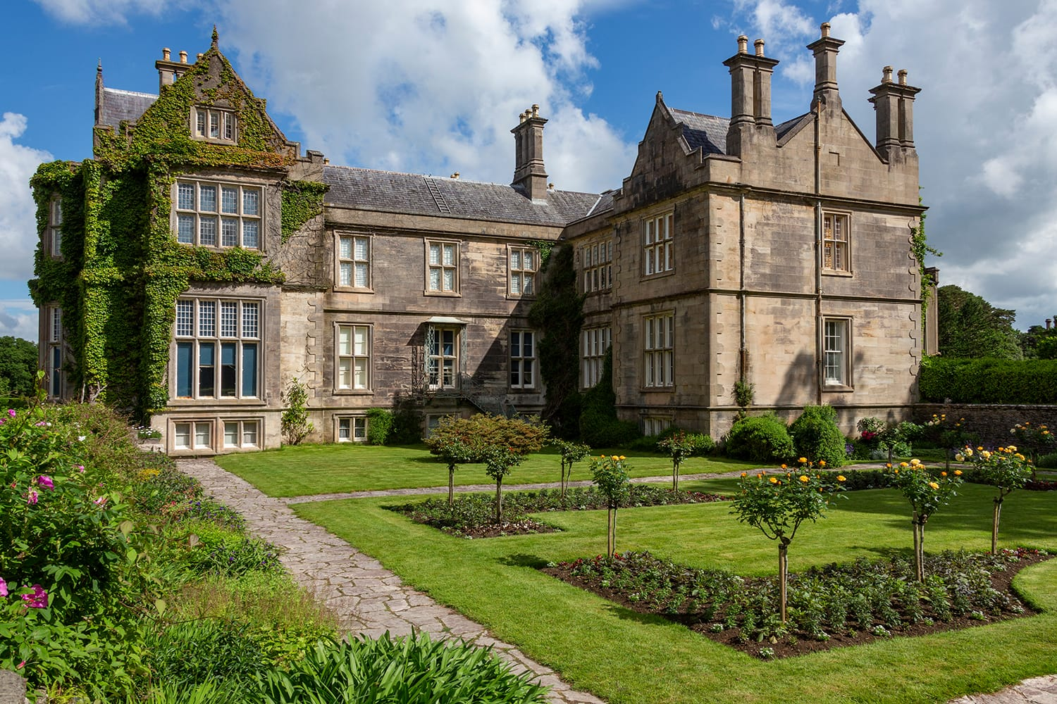 Muckross House - located on Muckross Peninsula between Muckross Lake and Lough Leane, two of the lakes of Killarney, 6km from Killarney in County Kerry, Ireland.