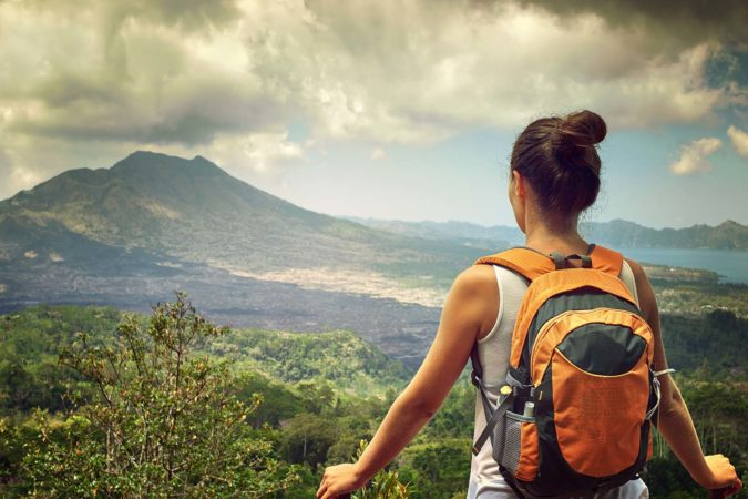 Woman traveling with packable backpack in Bali