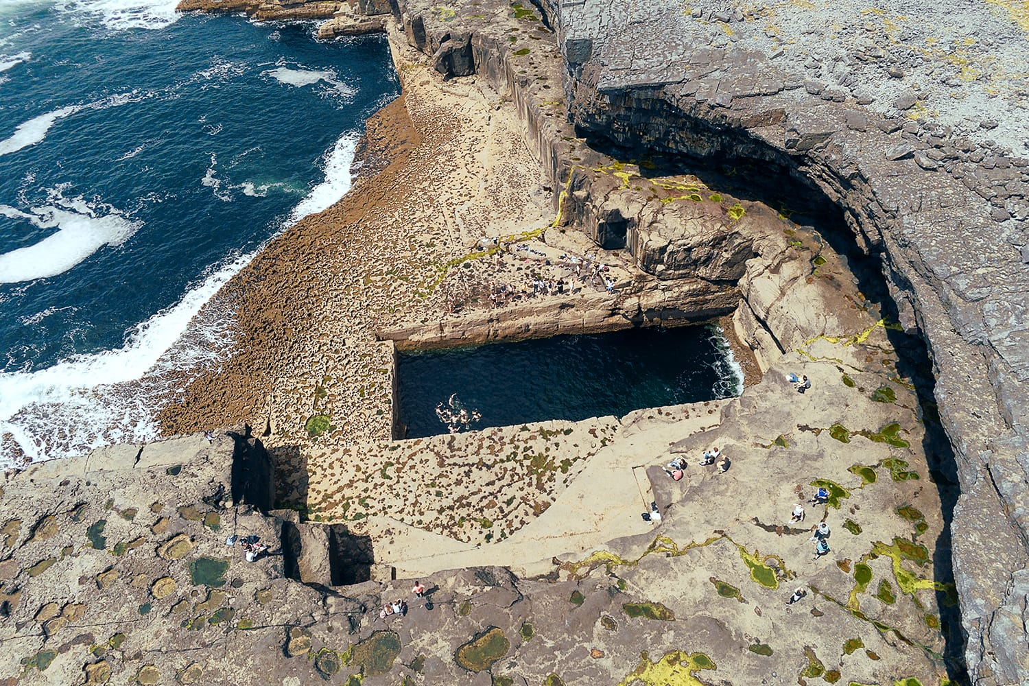 Aerial drone view on famous Poll na bPéist - The Wormhole, Inishmore, Aran islands, county Galway, Ireland.